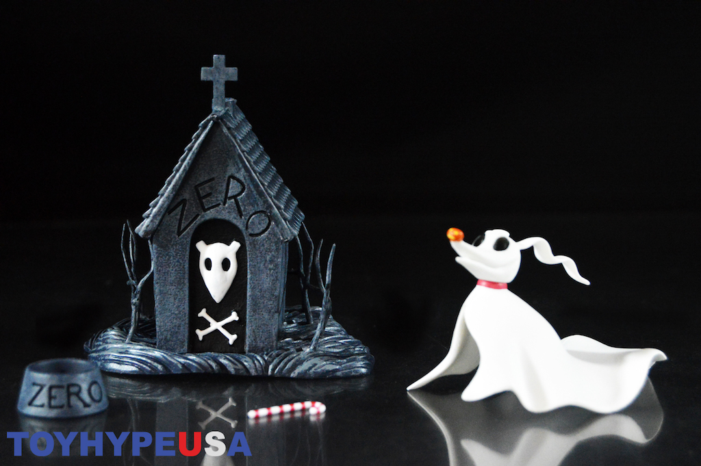 zero is sculpted as a ghost dog with a white cloth for a body that is made of plastic a long snout with a orange nose and long ears that are wave - How Was The Nightmare Before Christmas Made